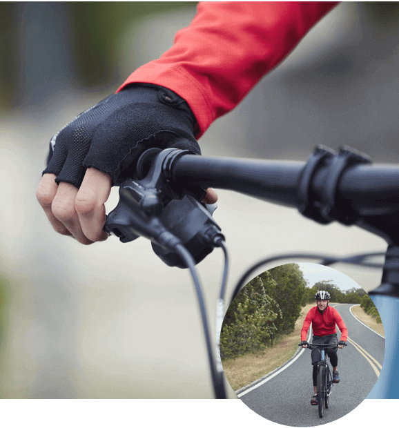 Person gripping bike handle