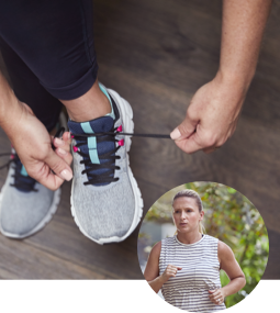 Woman tying her shoes to prepare for a jog